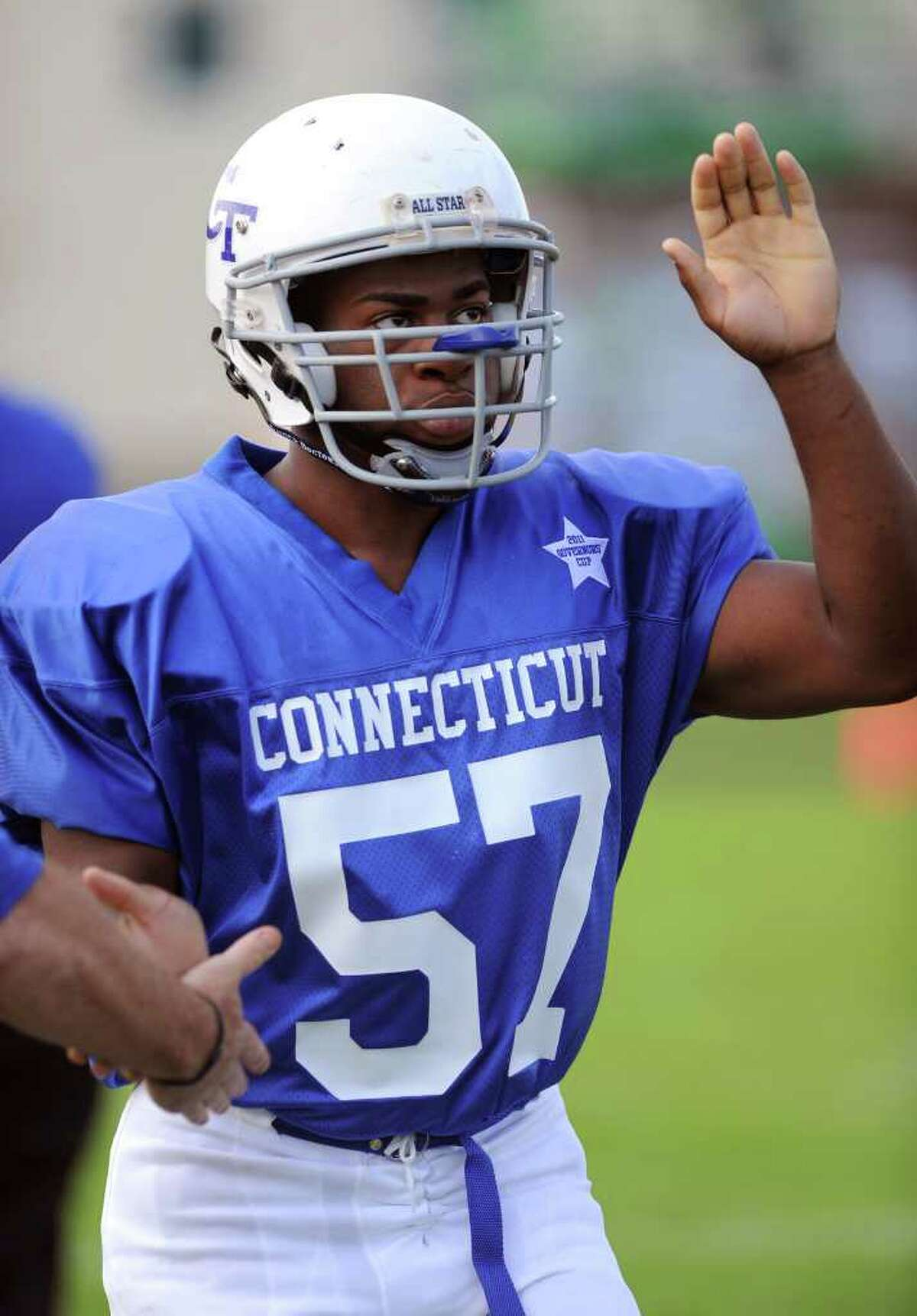 Stamford High School's Mark Robinson enters the field for the Connecticut High School football all-star game against Rhode Island on June 25, 2011, at Southington High School.