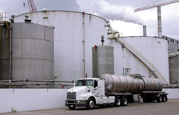 In this photo taken July 2009, a tanker truck loaded up with ethanol prepares to leave the Archer Daniels Midland Company plant in Decatur, Ill. While a Senate vote to end a tax credit that's helped build the ethanol industry in the United States signals that the subsidy's days may be numbered, corn farmers and ethanol makers hope they can convince Congress to compromise and agree to preserve but reduce subsidies. But agricultural economists say the ethanol industry has grown up over the last few years and doesn't need the help, and they doubt farmers or their customers in the ethanol industry would be hurt much if the subsidy dies. Photo: Seth Perlman, AP / AP