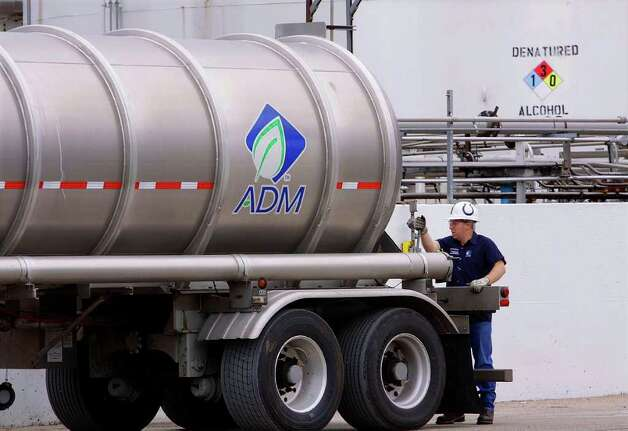 In this photo taken July, 2009, an unidentified ADM employee secures a tanker truck loaded up with ethanol at the Archer Daniels Midland Company plant in Decatur, Ill. While a Senate vote to end a tax credit that's helped build the ethanol industry in the United States signals that the subsidy's days may be numbered, corn farmers and ethanol makers hope they can convince Congress to compromise and agree to preserve but reduce subsidies. But agricultural economists say the ethanol industry has grown up over the last few years and doesn't need the help, and they doubt farmers or their customers in the ethanol industry would be hurt much if the subsidy dies. Photo: Seth Perlman, AP / AP