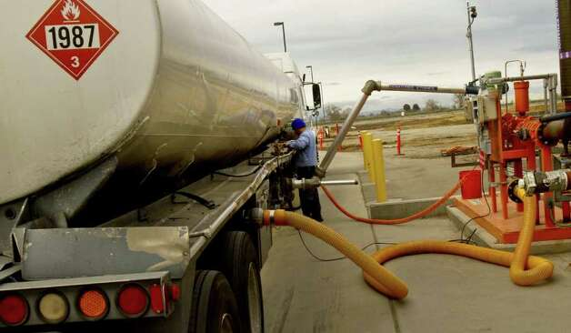 Ethanol is pumped into a truck for transport as ethanol production is coming back and Pacific Ethanol, Inc., in Stockton, California, has weathered bankruptcy and is cashing in on the current boon. Photo: Anne Cusack, MCT / Los Angeles Times