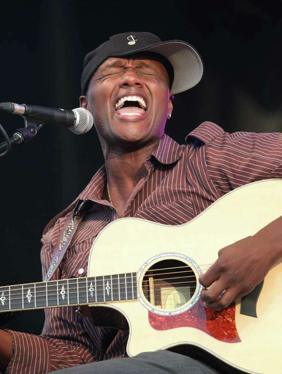"""Javier Colon, winner of the NBC reality talent show """"The Voice,"""" performs at the Cisco Ottawa Bluesfest on Tuesday, July 5, 2011. Colon will appear before fans at a homecoming celebration at his alma mater, Bunnell High School in Stratford, Conn. on Sunday July 10. (The Canadian Press Images PHOTO/Ottawa Bluesfest/Patrick Doyle via AP Images)"""
