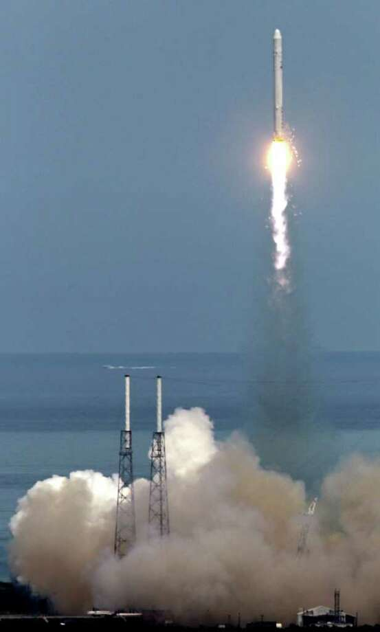 The SpaceX Falcon 9 test rocket lifts off from complex 40 at the Cape Canaveral Air Force Station in Cape Canaveral, Fla., Friday, June 4, 2010. The rocket is carrying a mock-up of the company's spacecraft, named Dragon. The goal is to put the capsule into orbit. NASA hopes to use the Falcon-Dragon combo for hauling cargo and possibly astronauts to the International Space Station, once the shuttles stop flying.  SpaceX, or Space Exploration Technologies, was founded eight years ago by Elon Musk, a South African-born entrepreneur who co-founded PayPal. (AP Photo/John Raoux) Photo: NASA / AP2010