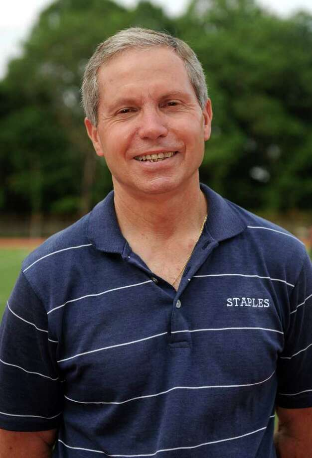 Laddlie Lawrence poses for a photo before the Westport Age Group Track Meet at Staples High School on July 7, 2011. Photo: Lindsay Niegelberg / Connecticut Post