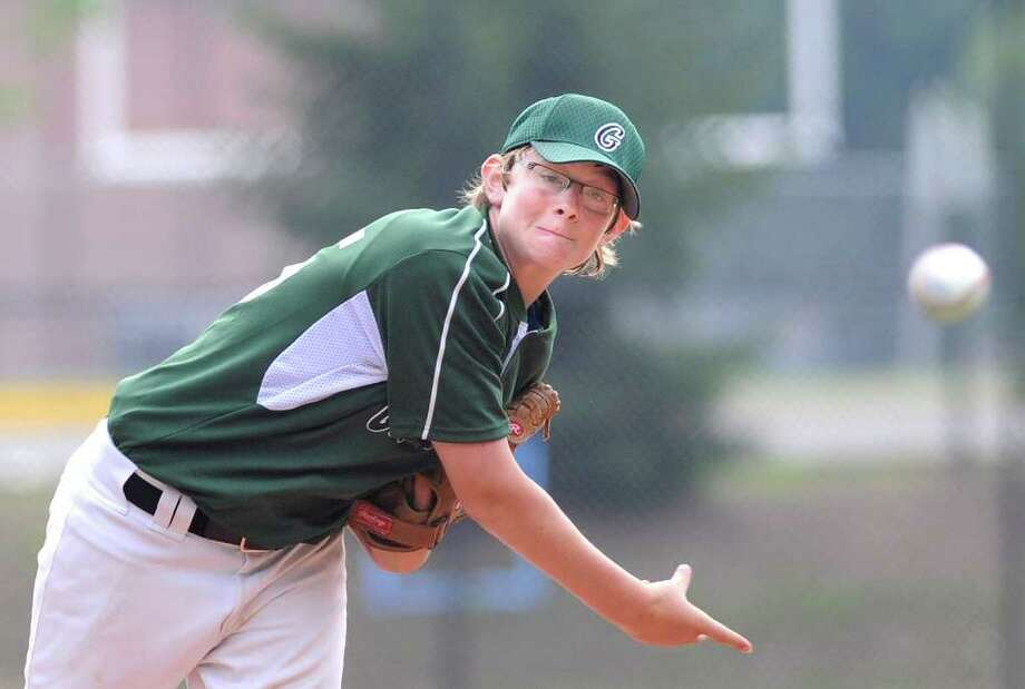 Spencer Matonis of Greenwich pitches during the top of the first inning during the Stamford vs. Greenwich U-13 Babe Ruth baseball tournament game at Darien High School Thursday night, July 7, 2011. Photo: Bob Luckey / Greenwich Time