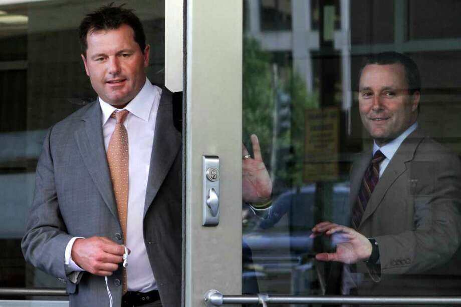 Former baseball pitcher Roger Clemens, left, leaves federal court with his attorney, Michael Attanasio, in Washington, on Thursday, July 7, 2011.  Clemens faces six felony counts on accusations he lied to Congress under oath when he testified that he never used steroids or human growth hormone. (AP Photo/Jacquelyn Martin) Photo: Jacquelyn Martin, STF / AP