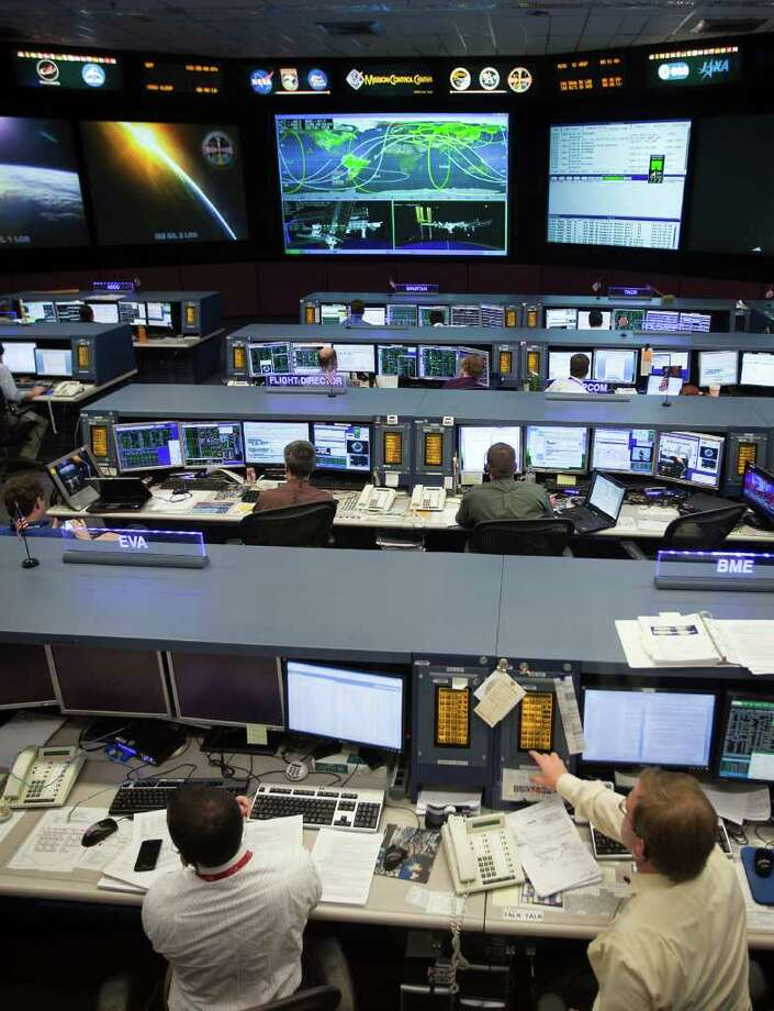 Controllers work in The International Space Station control room at NASA's Mission Control Center at the Johnson Space Center on Wednesday, June 15, 2011, in Houston. ( Smiley N. Pool / Houston Chronicle ) Photo: Smiley N. Pool, Staff / © 2011  Houston Chronicle