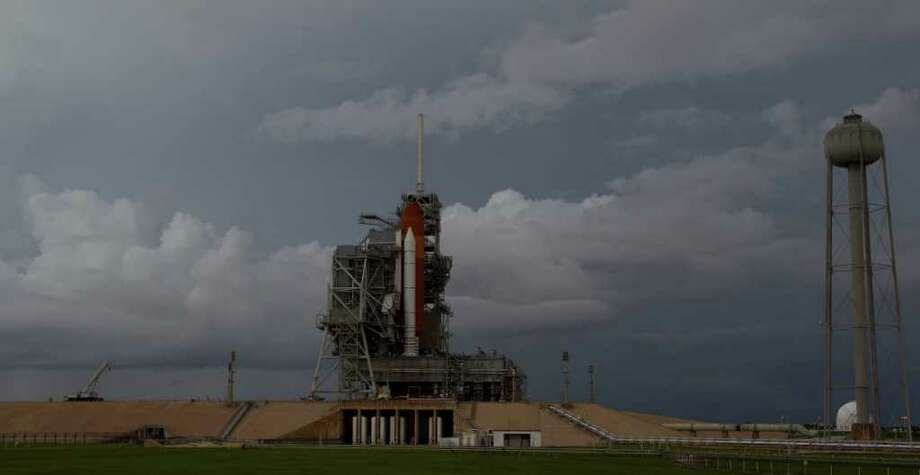 The space shuttle Atlantis sits on launch pad 39A during the RSS (Rotating Service Structure) Rollback awaiting the STS-135 international space station mission which is the final launch of the shuttle program Thursday, July 7, 2011, in Kennedy Space Center. ( James Nielsen / Chronicle ) Photo: James Nielsen, Staff / © 2009 Houston Chronicle