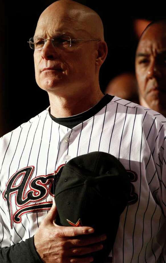 Houston Astros manager Brad Mills (2) listens to the National Anthem before his game against  the Atlanta Braves Friday, June 10, 2011, in Minute Maid Park in Houston. ( Nick de la Torre / Houston Chronicle ) Photo: Nick De La Torre, Staff / © 2010 Houston Chronicle