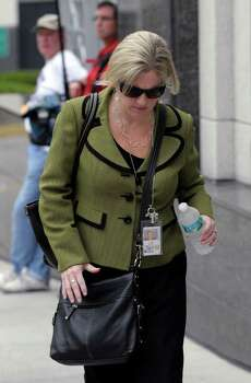 State attorney Linda Drane Burdick arrives at the Orange County Courthouse for the Casey Anthony sentencing in Orlando, Fla., Thursday, July 7, 2011.  Judge Belvin Perry sentenced  Anthony to four years for lying to investigators but says she can go free in late July or early August because she has already served nearly three years in jail and has had good behavior. While acquitted of killing and abusing her 2-year-old daughter Caylee, Anthony was convicted of four counts of lying to detectives trying to find her daughter in July 2008. (AP Photo/Phelan M. Ebenhack) Photo: Phelan M. Ebenhack