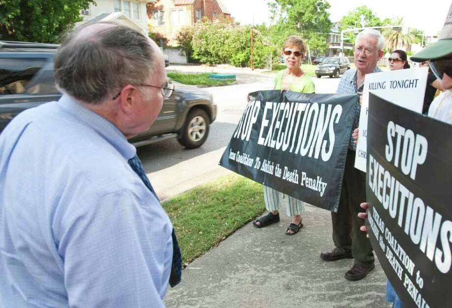 Charles Crumb, M.D., of Houston, left, is for the death penalty and argues points with David Atwood of the Texas Coalition to Abolish the Death Penalty during a protest the execution of Humberto Leal Thursday, July 7, 2011, outside St. Stephen's Episcopal Church & School in Houston. Crumb says he thinks there should be an effort to keep illegals from killing innocent children, rather than stop a system that works. Atwood says he against the death penalty on moral ground, prison insures public safety amongst other things.  ( Nick de la Torre / Houston Chronicle ) Photo: Nick De La Torre, Staff / © 2010 Houston Chronicle