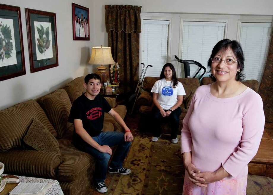 6/24/2011: KIPP is launching a new $7.5 million program to help families finance college education. As part of the program, families are provided matching funds for money they put into college savings. Participating families are also eligible for large scholarships. Rebeca Figuroa, a housekeeper for a River Oaks family, plans to start saving $20 a week for her 17-year-old son, John who will graduating in 2012. He's the youngest of her four children, all of whom have attended college. She also has a 18-year-old daughter, Becky  who graduated from Kipp last month. and will be attending Concordia University in Austin, Texas this fall majoring in literature.(The program was not started in time for her, but it would be fine to include her in the photo.) Special to the Chron: Thomas B. Shea Photo: Thomas B. Shea / Special To The, Thomas B. Shea