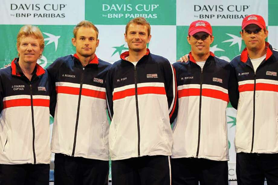AUSTIN, TX - JULY 07:  Members of the US Davis Cup team (l-r) Captain Jim Courier, Andy Roddick, Mardy Fish, Mike Bryan and Bob Bryan pose for photographers after the draw ceremony for their tie against Spain held at The Moody Theatre on July 7, 2011 in Austin, Texas.  (Photo by Matthew Stockman/Getty Images) Photo: Matthew Stockman, Staff / 2011 Getty Images