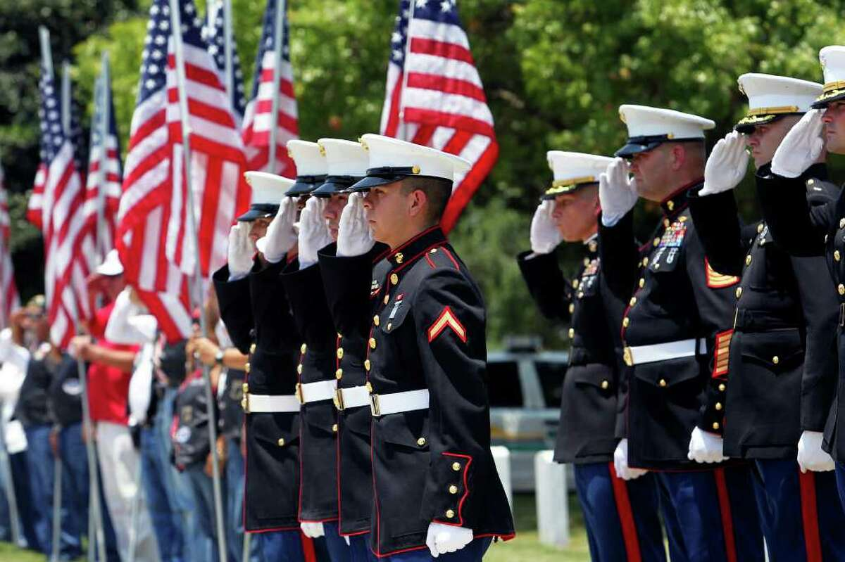 Marines salute the casket of Lance Cpl. John Farias at his Fort Sam Houston National Cemetery burial service on Thursday, July 7, 2011.