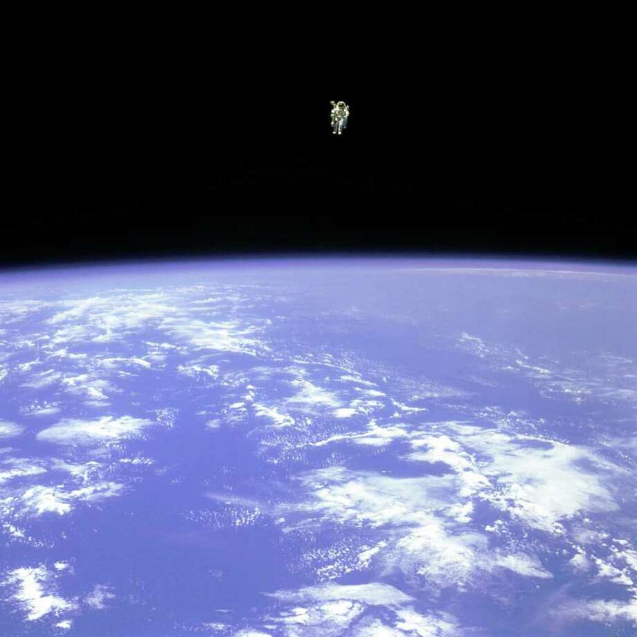 "Mission Specialist Bruce McCandless II, is seen further away from the confines and safety of his ship than any previous astronaut has ever been. This space first was made possible by the Manned Manuevering Unit or MMU, a nitrogen jet propelled backpack. After a series of test maneuvers inside and above Challenger's payload bay, McCandless went ""free-flying"" to a distance of 320 feet away from the Orbiter. This stunning orbital panorama view shows McCandless out there amongst the black and blue of Earth and space. Keywords  STS-41B Challenger Manned Maneuvering Unit MMU Bruce McCandless Extravehicular Activity EVA Spacewalk Subject Category  Space Shuttle, EVAs-Spacewalk, Reference Numbers  Center: JSC Center Number: S84-27031 GRIN DataBase Number: GPN-2000-001087 Source Information  Creator/Photographer: NASA Original Source: DIGITAL Photo: NASA / NASA"