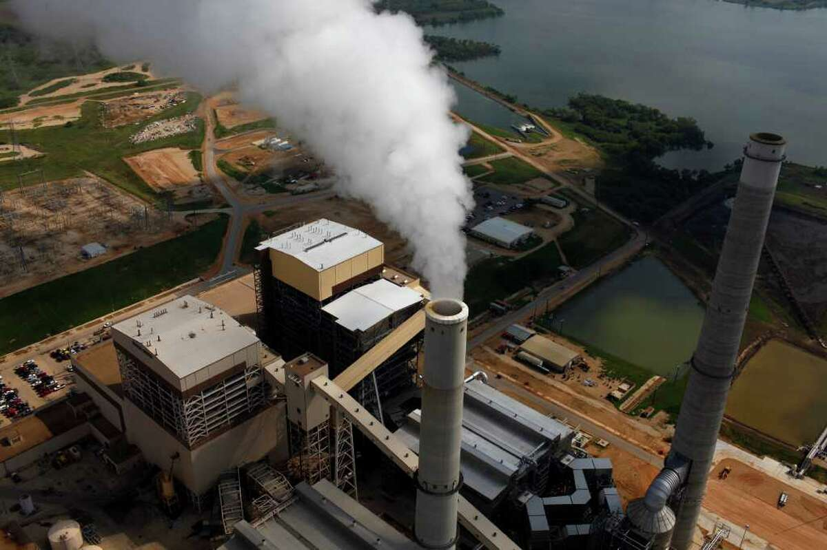 CPS Energy's two newer coal plants, Spruce I (left) and II, are equipped with pollution-control equipment that should keep them operating within the EPA's new rules. The utility company won for sustainability at the Downtown Alliance's 12th annual Downtown's Best Awards.