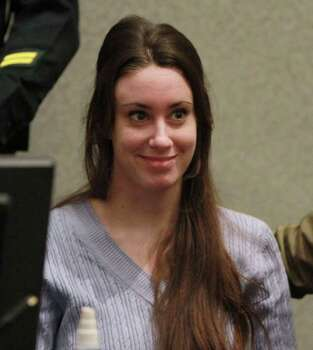 Casey Anthony waits in the courtroom before the start of her sentencing hearing in Orlando, Fla.,Thursday, July 7, 2011.   Judge Belvin Perry sentenced Anthony to four years for lying to investigators.   Anthony  could be free in a matter of weeks after spending nearly three years in jail on accusations she murdered her 2-year-old daughter.   While acquitted of killing and abusing her daughter, Caylee, Anthony was convicted of four counts of lying to detectives trying to find her daughter. Photo: AP