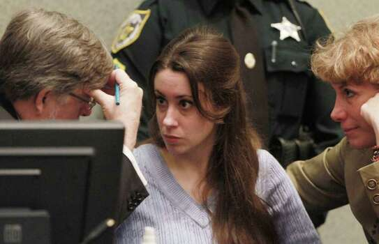 Casey Anthony talks with her attorneys, Cheney Mason, left, and Dorothy Clay Sims before the start of her sentencing hearing at the Orange County Courthouse in Orlando, Fla., Thursday, July 7, 2011. Judge Belvin Perry sentenced Anthony to four years for lying to investigators but says she can go free in late July or early August due to her good behavior. While acquitted of killing and abusing her daughter, Caylee, Anthony was convicted of four counts of lying to police officials trying to find her daughter. Photo: AP