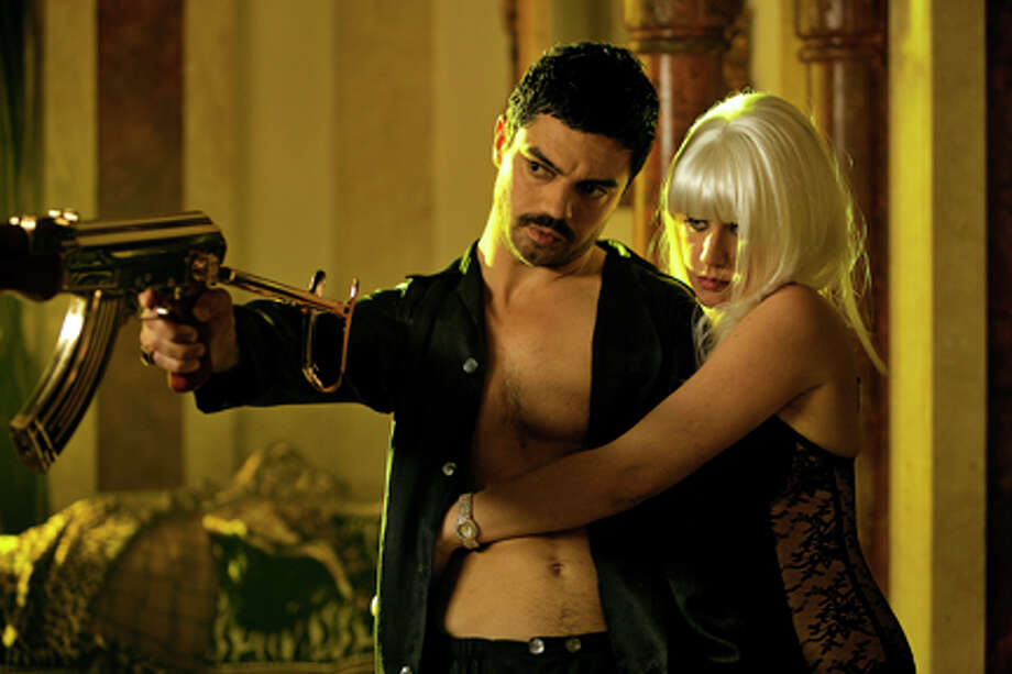 "Dominic Cooper as Latif Yahia and Ludivine Sagnier as Sarrab in ""The Devil's Double."" Photo: Photo Credit: Sofie Van Mieghem"