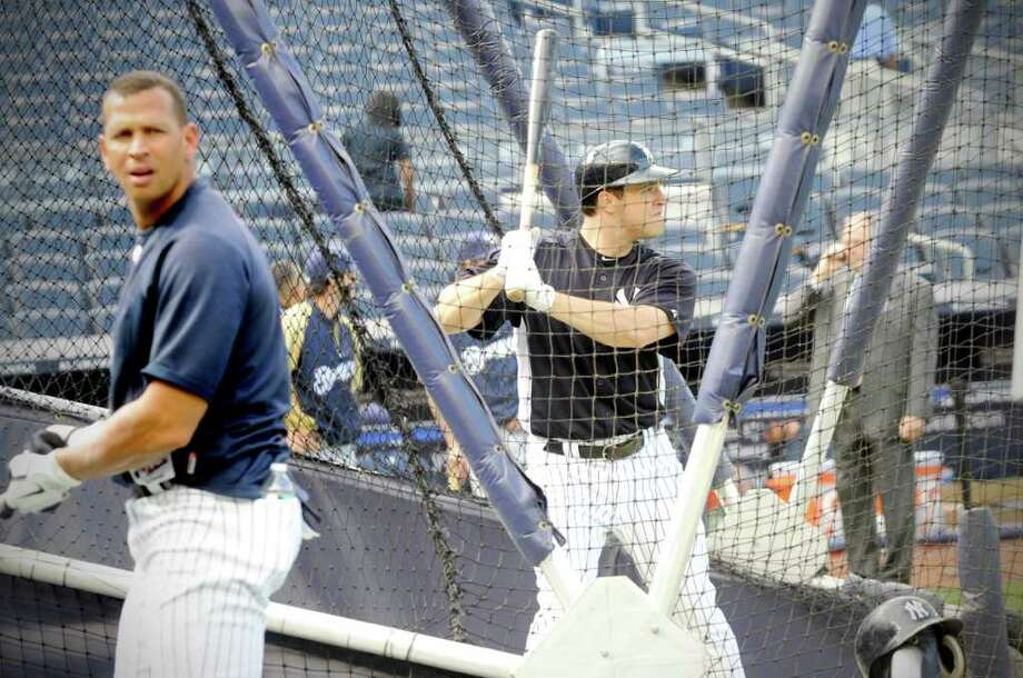 "Switch-hitting New York Yankees first baseman and Greenwich resident Mark Teixeira warms up in the batting cage from the right side of the plate recently at Yankee Stadium. Teixeira is happy to be a Yankee and happy to live in Greenwwich. ""I can't imagine a better place to live than Greenwich and I've lived all over the country,"" says Teixeira. Photo: Keelin Daly / Stamford Advocate"