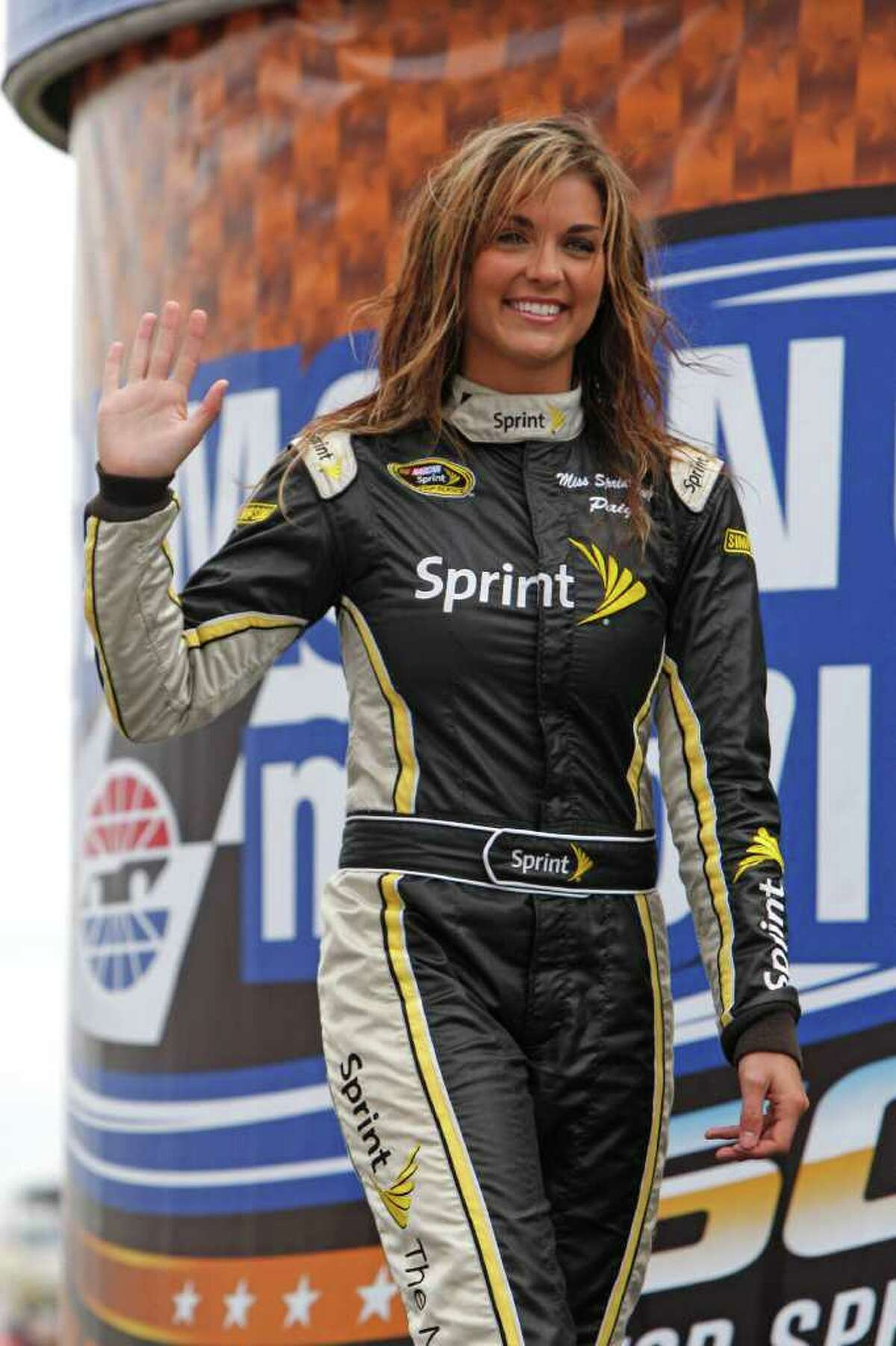 FILE - This April 19, 2010, file photo shows Miss Sprint Cup Paige Duke during driver introductions before the start of the NASCAR Sprint Cup Samsung Mobile 500 auto race at Texas Motor Speedway, in Fort Worth, Texas. NASCAR's Miss Sprint Cup has been let go after nude pictures of her appeared online. Paige Duke told The Charlotte Observer the pictures were taken when she was a freshman at Clemson University and were only meant for her boyfriend at the time.