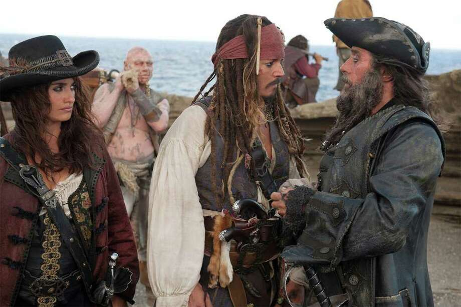 "Angelica (Penelope Cruz), Captain Jack Sparrow (Johnny Depp) and Blackbeard (Ian McShane) debate their next moves in a quest for the Fountain of Youth in a scene from ""Pirates of the Caribbean: On Stranger Tides,"" which opens at the Maritime Aquarium July 15. Photo: Contributed Photo"