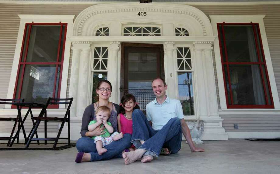 Todd Morey and Shannon Hearn at home on their porch with daughter Sophia 8, and son Abram, 9 months. Photo: EDWARD A. ORNELAS, SAN ANTONIO EXPRESS-NEWS / © SAN ANTONIO EXPRESS-NEWS (NFS)