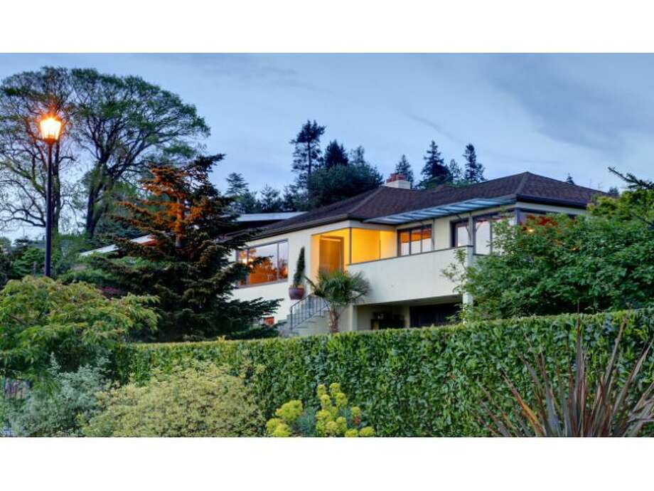 Want to live in style above Puget Sound, between Golden Gardens and Carkeek Park? Check out this home at 2411 N.W. Blue Ridge Drive. The 3,740-square-foot house was built in 1946 and features four bedrooms, 2.75 bathrooms, colorful kitchen tile, a patio with a cool outdoor fire pit, a 6,000-square-foot lot and, of course, views across the sound to the Olympic Mountains. It's listed for $1.4 million. (Listing: www.windermere.com/index.cfm?fuseaction=listing.listingDetailUpdated&listingID=130142378&paginate=true) Photo: Windermere Real Estate