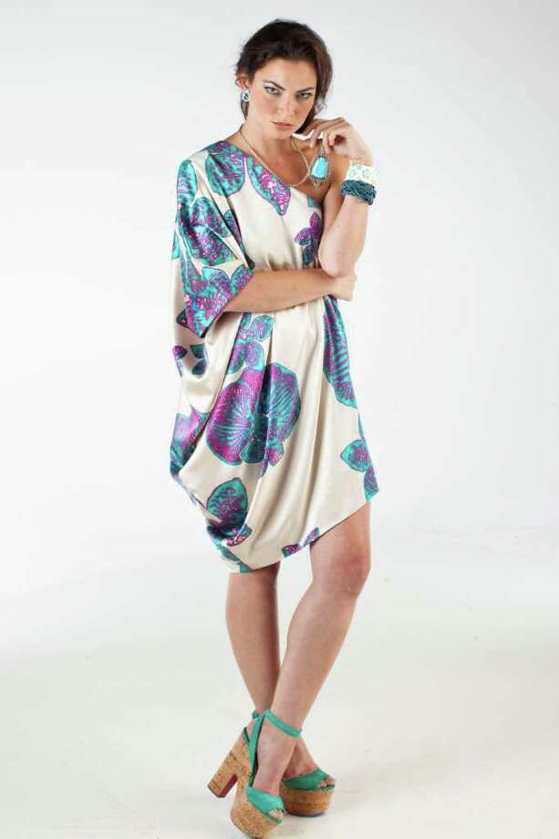 (white print)  Angelique Gioldasis of Page.713 wears a Halston Heritage caftan, $395, and necklace, $68, Nordstrom. Earrings, $178, and cuff, $328, A Bientot. Styling: Dawn Bell. Hair and makeup: Carol Wagener.  For the July Gloss cover story on caftans, photographed in the Houston Chronicle Photo Studio, Wednesday, June 8, 2011, in Houston. Photo: Michael Paulsen, Houston Chronicle / © 2011 Houston Chronicle