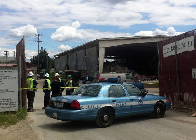 A man's body was found on a conveyer belt at a recycling plant in the 7200 block of East Marginal Way South the morning of July 8, 2011. Photo: Casey McNerthney/seattlepi.com