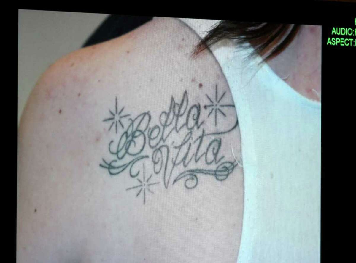 A photograph of a tattoo that Casey Anthony received by tattoo artist Booby Williams while her daughter Caylee was reported missing is displayed on a monitor after being entered into evidence during day 18 of the Casey Anthony murder trial at the Orange County Courthouse, in Orlando, Fla., Tuesday, June 14, 2011. Anthony, 25, is charged with killing her 2-year old daughter in 2008.(AP Photo/Red Huber, Pool)
