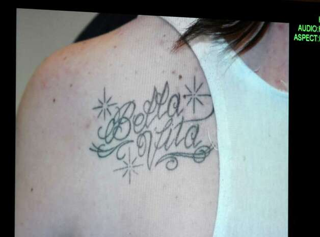 A photograph of a tattoo that Casey Anthony received by tattoo artist Booby Williams while her daughter Caylee was reported missing is displayed on a monitor after being entered into evidence during day 18 of the Casey Anthony murder trial at the Orange County Courthouse, in Orlando, Fla., Tuesday, June 14, 2011.  Anthony, 25,  is charged with killing her 2-year old daughter in 2008.(AP Photo/Red Huber, Pool) Photo: Red Huber, POOL / Pool Orlando Sentinel