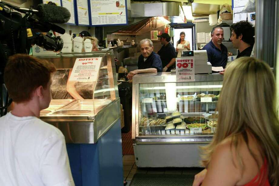 """Garden Catering employee Frank """"Hotsy"""" Bertino, center, will be turning 90 on Monday.  In honor of the occassion, the shop will be selling 90-cent """"Hotsy"""" sandwiches. Bertino, center, is seen here on Friday, July 8, 2011. Photo: David Ames, David Ames/For Greenwich Time / Greenwich Time Freelance"""