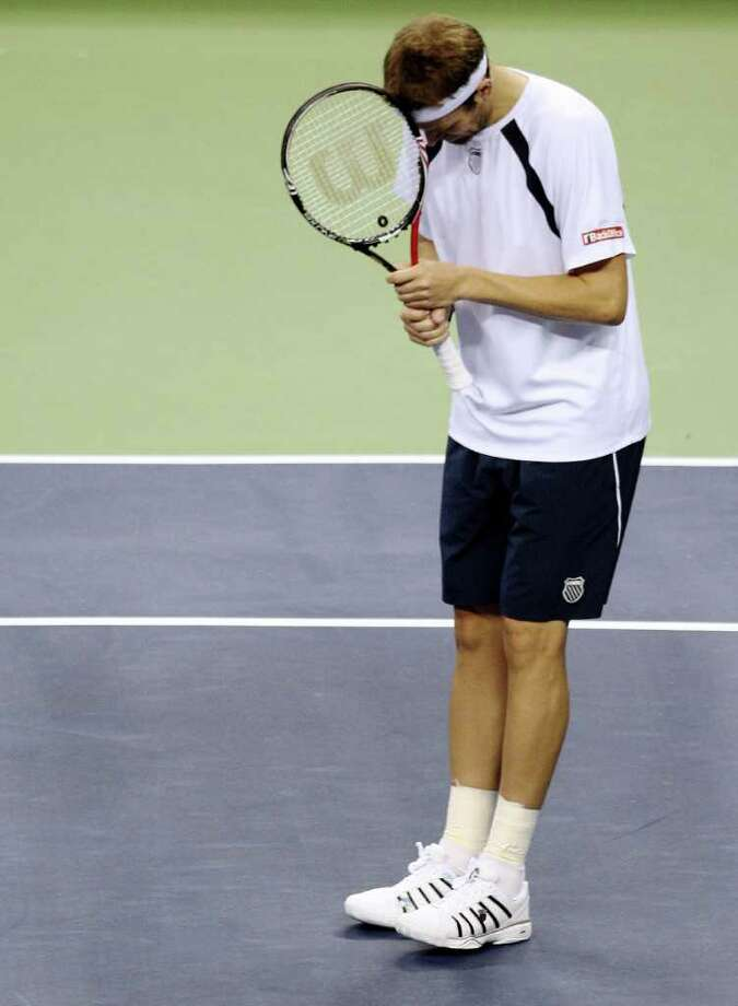 Mardy Fish of the U.S. reacts after losing a point to Feliciano Lopez of Spain during a game of the Davis Cup tennis quarterfinal match Friday, July 8, 2011 in Austin, Texas. (AP Photo/Kim Johnson Flodin) Photo: Kim Johnson Flodin, STF / AP