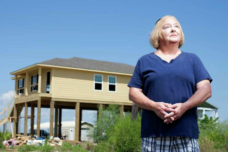 Peggy LeRoystands in front of what she hopes will be her new home Thursday, July 7, 2011, in Port Bolivar. Her original home was destroyed in Hurricane Ike. The LeRoy's have rebuild with the help of the Galveston County disaster program and Catholic Charities for furniture. ( Nick de la Torre / Houston Chronicle ) Photo: Nick De La Torre, Staff / © 2010 Houston Chronicle