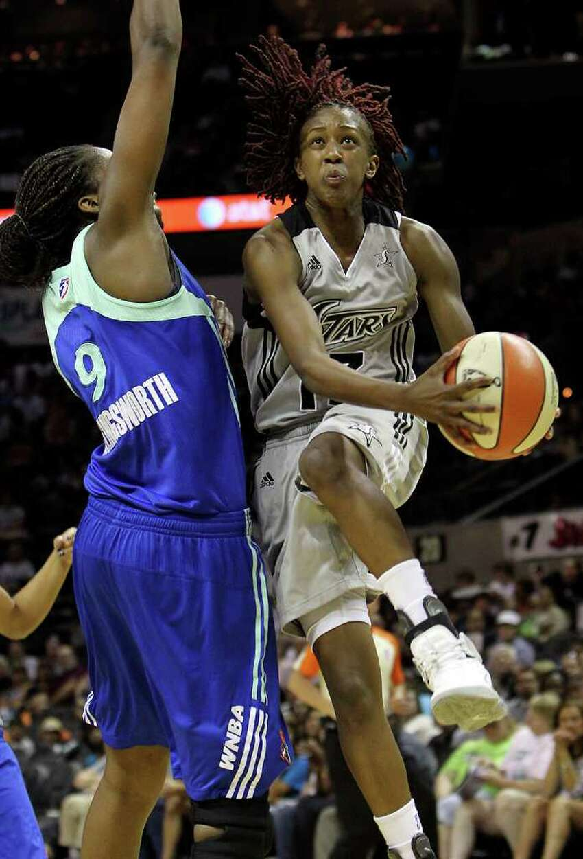 Silver Stars' Danielle Robinson (13) drives to the basket against New York Liberty's Quanitra Hollingsworth (09) in the first half at the AT&T Center on Friday, July 8, 2011. Kin Man Hui/kmhui@express-news.net