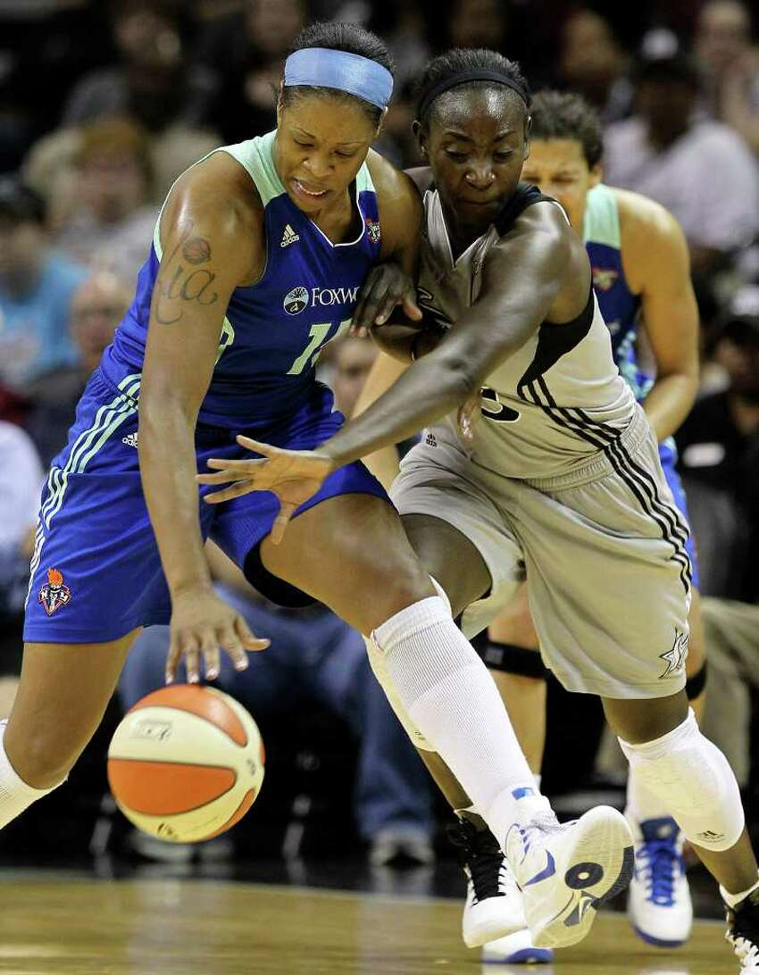Silver Stars' Sophia Young (right) challenges for the ball against New York Liberty's Kia Vaughn (15) in the first half at the AT&T Center on Friday, July 8, 2011. Kin Man Hui/kmhui@express-news.net