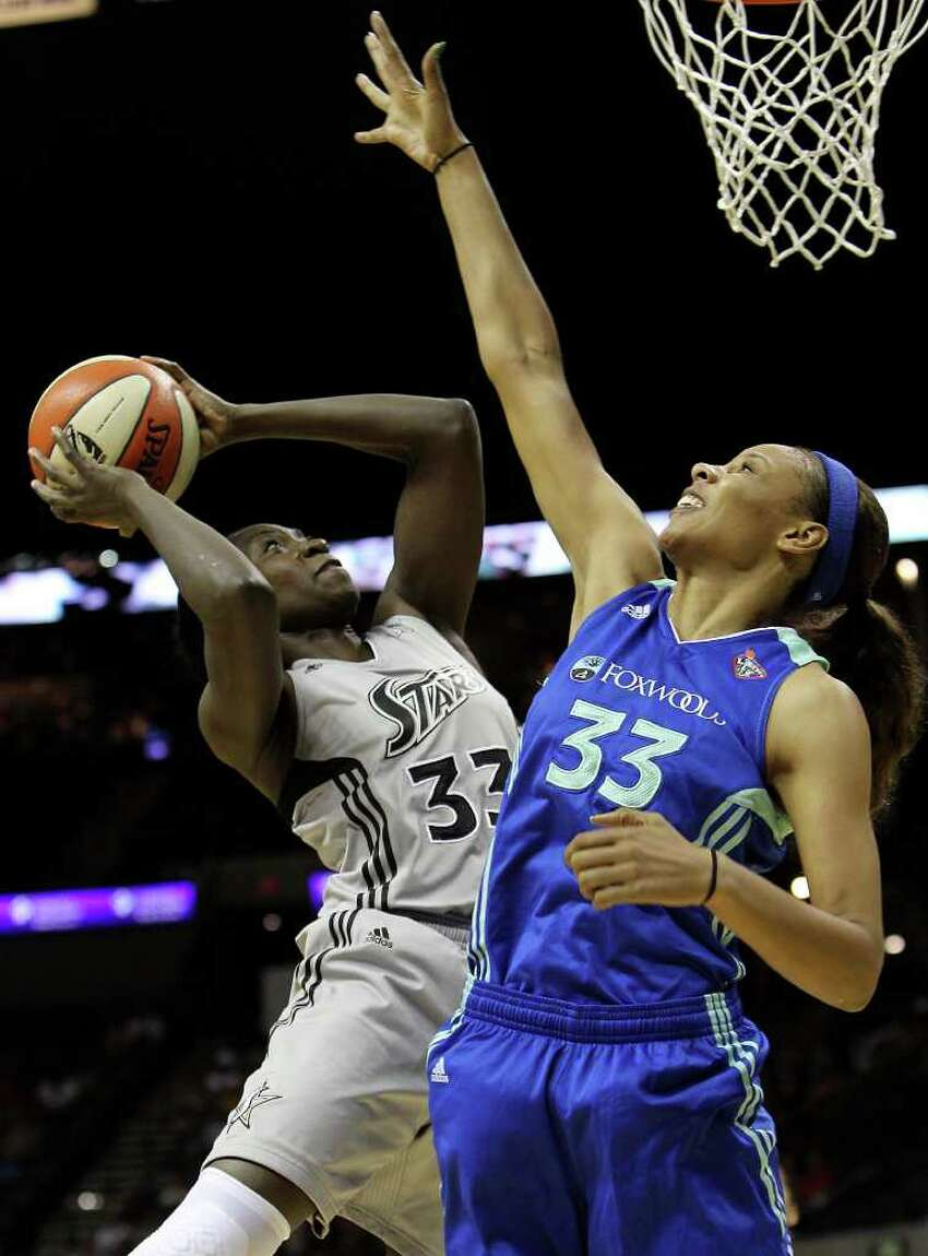 Silver Stars' Sophia Young (left) takes a shot against New York Liberty's Pienetter Pierson (right) in the first half at the AT&T Center on Friday, July 8, 2011. Kin Man Hui/kmhui@express-news.net