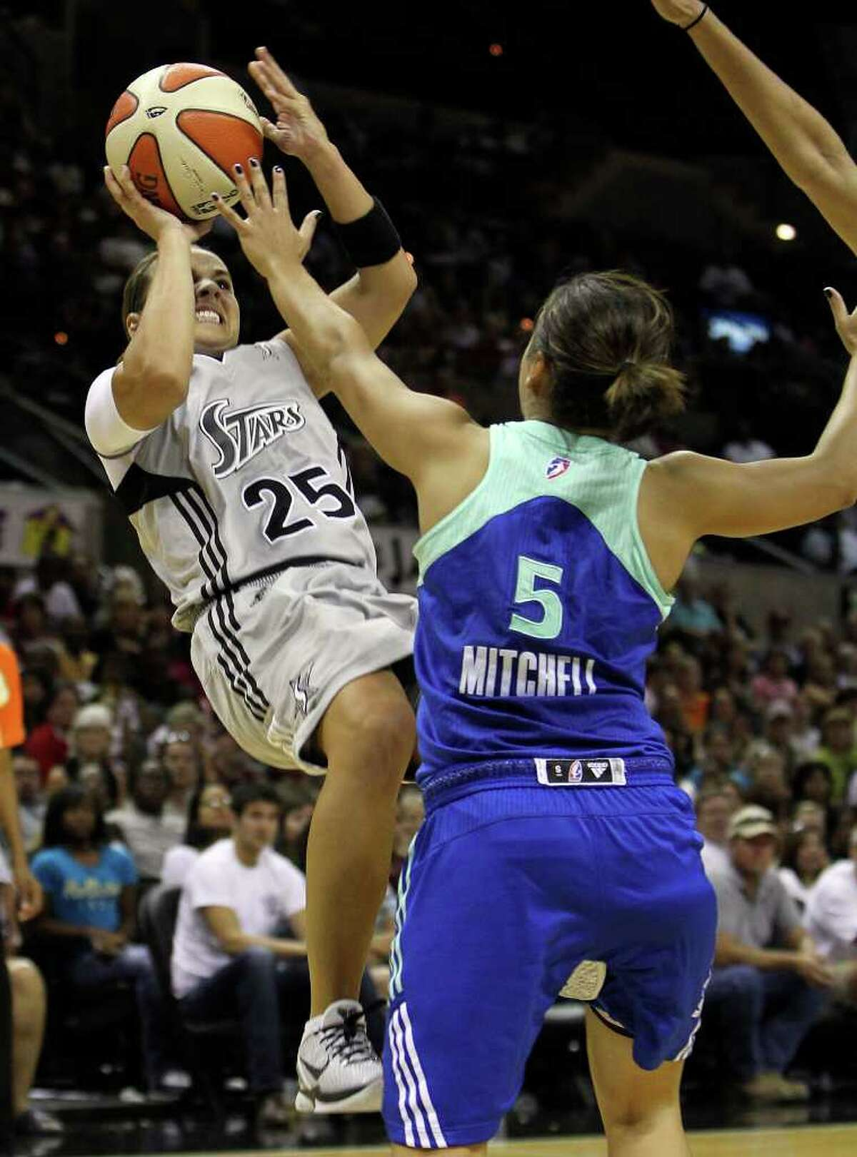 Silver Stars' Becky Hammon (left) falls back for a jumper against New York Liberty's Leilani Mitchell (05) in the second half at the AT&T Center on Friday, July 8, 2011. Silver Stars lose to Liberty, 73-76. Kin Man Hui/kmhui@express-news.net