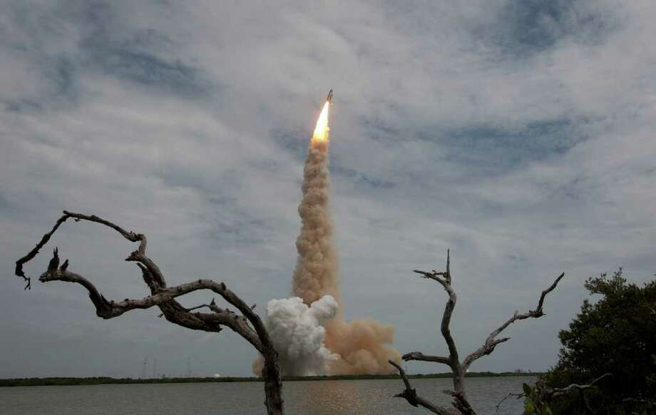 The space shuttle Atlantis lifts off from launch pad 39A for the STS-135 international space station mission for the final launch of the shuttle program Friday, July 8, 2011, in Kennedy Space Center. ( James Nielsen / Chronicle ) Photo: James Nielsen, Staff / © 2011 Houston Chronicle