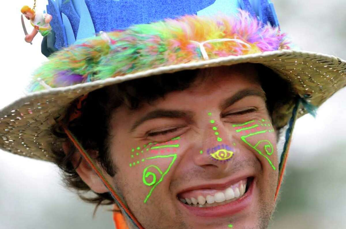 Shane Drosi, 21, of Knoxville, Tenn. wears a festive hat at Camp Bisco on Friday, July 8, 2011, in Pattersonville, N.Y. (Cindy Schultz / Times Union)