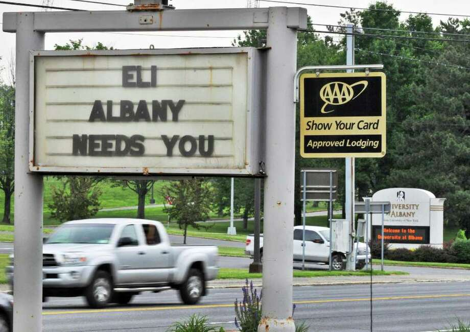 A message to NY Giant's QB Eli Manning outside the Best Western on Western Ave. in Albany Friday July 8, 2011.  (John Carl D'Annibale / Times Union) Photo: John Carl D'Annibale
