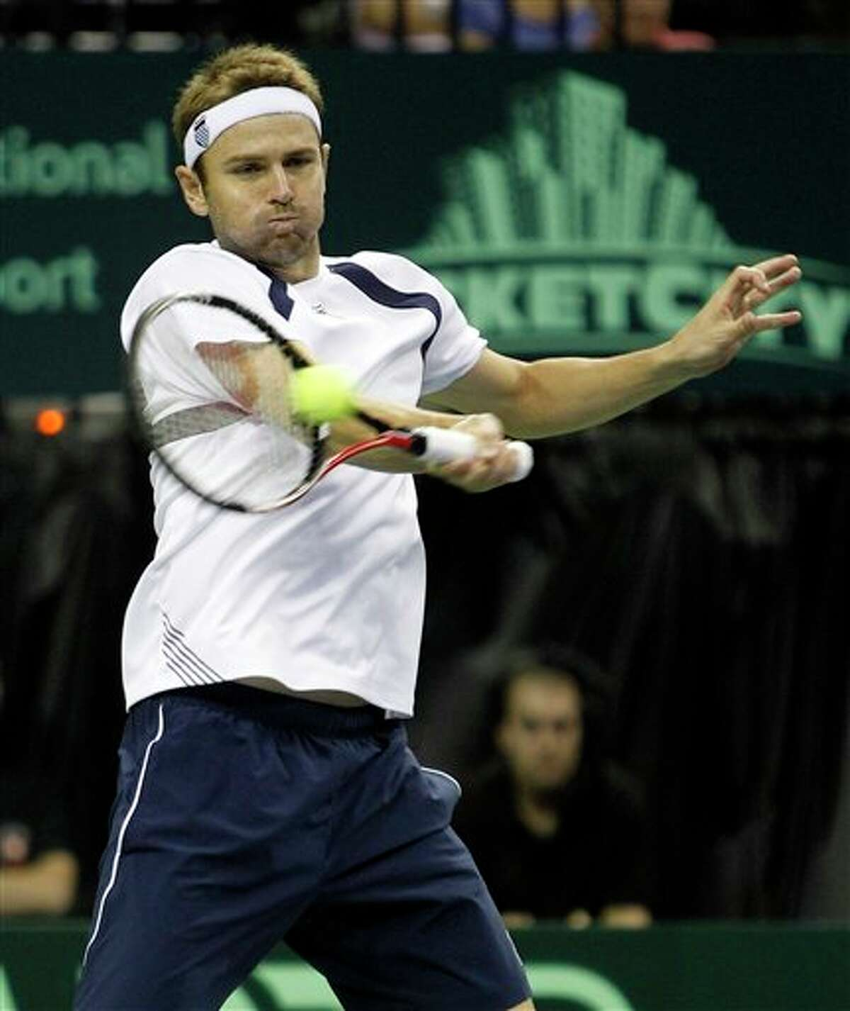 Mardy Fish of the U.S. returns the ball to Feliciano Lopez of Spain during the Davis Cup quarterfinal tennis match, Friday, July 8, 2011, in Austin, Texas. (AP Photo/Eric Gay)