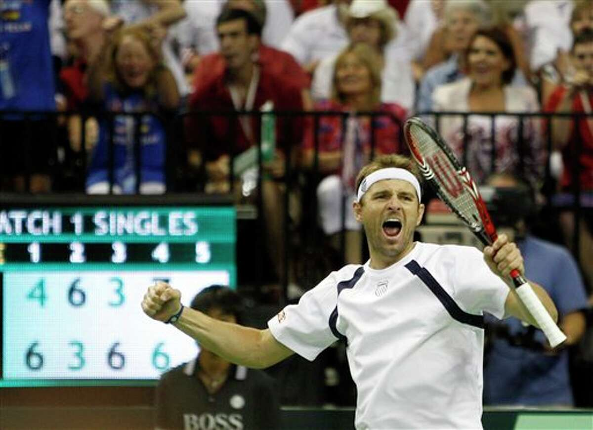 Mardy Fish of the U.S. reacts after winning a tie break in the fourth set against Feliciano Lopez of Spain during the Davis Cup quarterfinal tennis match Friday, July 8, 2011 in Austin, Texas. (AP Photo/Eric Gay)