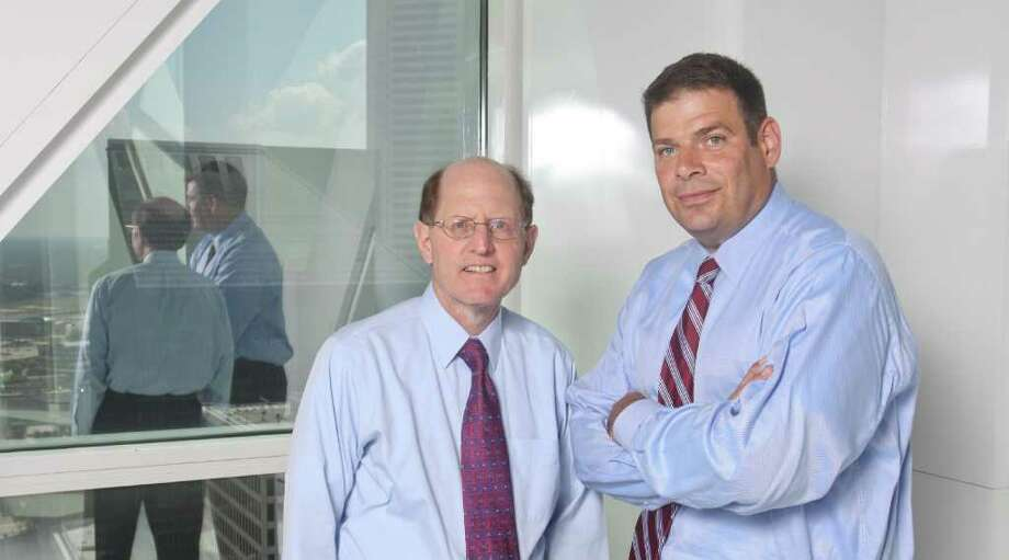 (For the Chronicle/Gary Fountain, July 7,  2011) Michael Abbott, left, and Marshall Cobb cut 401(k) fees because the Gardere Law Firm switched to a mix of lower cost index funds and negotiated a separate fee for record keeping. These two moves illustrate how more employers are starting to take a more jaundiced look at their 401(k) offerings and forcing their providers to cut costs. Gardere lawyer Michael Abbott spearheaded the effort as chairman of the firm's retirement committee. Marshall Cobb is Gardere's 401(k) advisor. Photo: Gary Fountain, Freelance / Copyright 2011 Gary Fountain Telephone:  281-531-0260