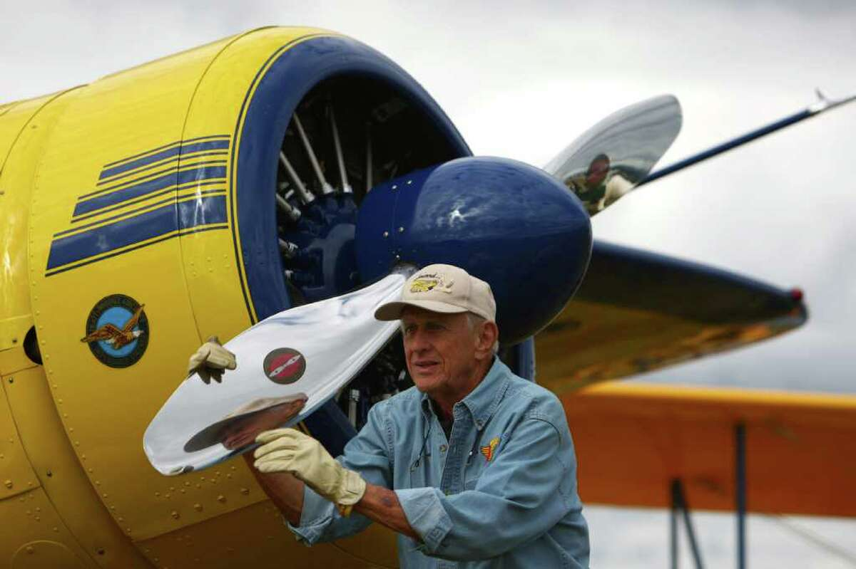 Fred Lundeen of Olympia turns the propeller of his 1944 Howard DGA-15P for the return trip to Olympia during the 2011 Arlington Fly-In and air show on Friday, July 8, 2011 at the Arlington Airport. The annual event continues through July 10th and features airshows and hundreds of aircraft and exhibits.