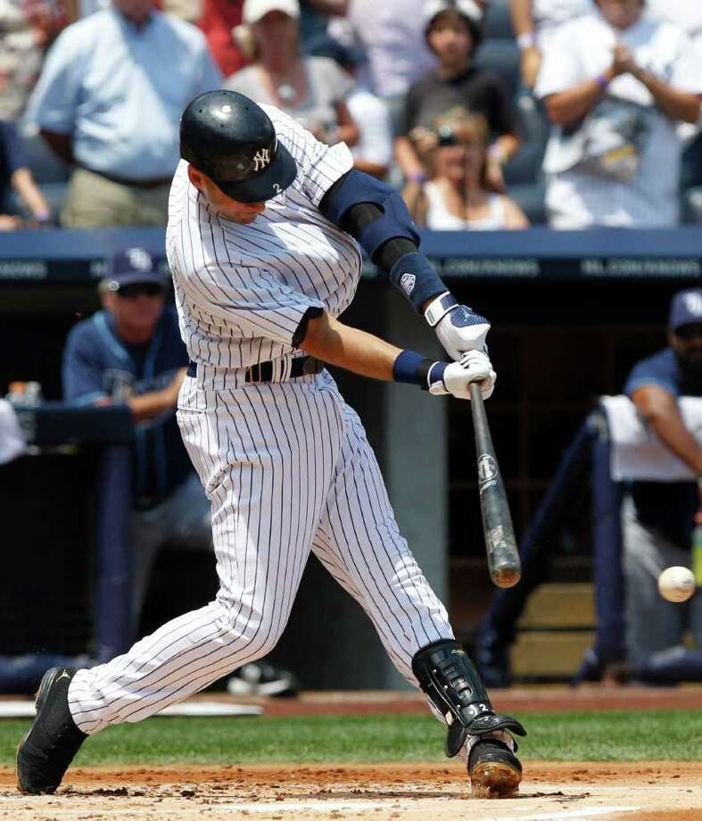 New York Yankees' Derek Jeter follows through on a single during the first inning of a baseball game against the Tampa Bay Rays, Saturday, July 9, 2011, at Yankee Stadium in New York. (AP Photo/Frank Franklin II) Photo: Frank Franklin II, STF / AP