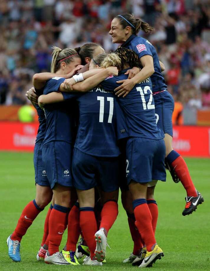France teammates celebrate their side's first goal during the quarterfinal match between England and France at the Women?s Soccer World Cup in Leverkusen, Germany, Saturday, July 9, 2011. (AP Photo/Frank Augstein) Photo: Frank Augstein, STF / AP