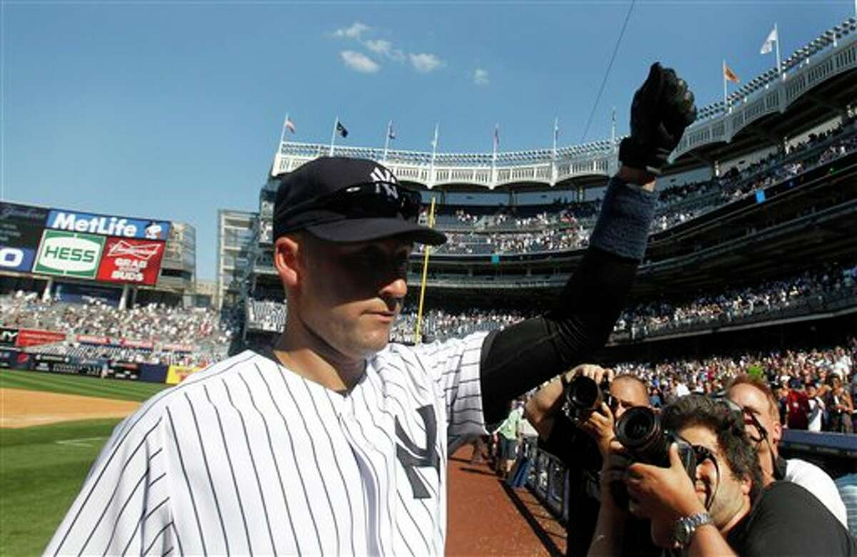 New York Yankees' Derek Jeter gestures to the crowd while leaving the field after a baseball game against the Tampa Bay Rays ,Saturday, July 9, 2011, at Yankee Stadium in New York. The Yankees won the game 5-4. Jeter homered for his 3,000th hit while going 5 for 5 with the tiebreaking single in the eighth inning. (AP Photo/Frank Franklin II)