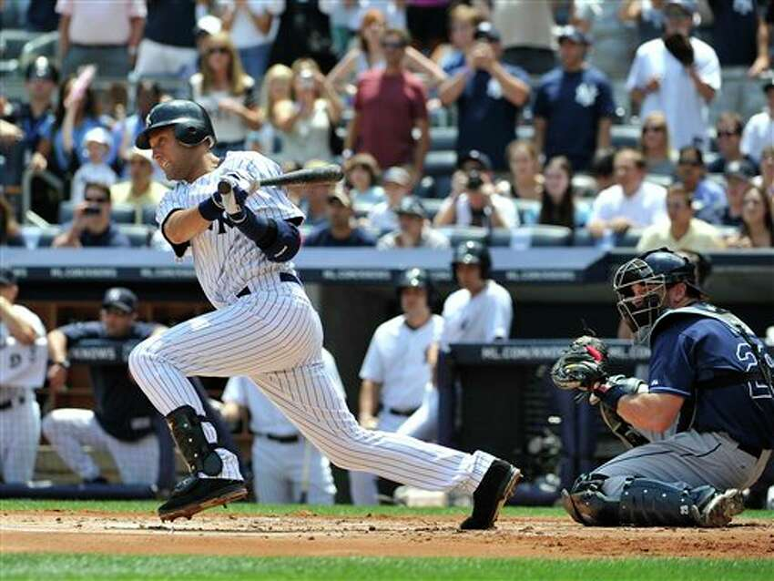 New York Yankees' Derek Jeter singles for his 2,999th career hit, in the first inning of a baseball game off of Tampa Bay Rays starting pitcher David Price on Saturday, July 9, 2011 at Yankee Stadium in New York. Tampa Bay Rays catcher is John Jaso. (AP Photo/Kathy Kmonicek)