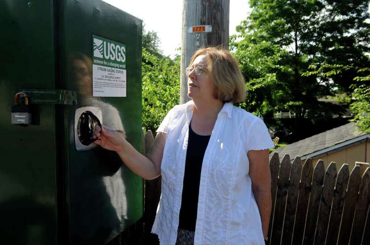Denise Savageau, Greenwich conservation director, looks at a stream gauge on the Comley Avenue Bridge on Wednesday, June 29, 2011. Savageau is concerned about recurring droughts in Greenwich.